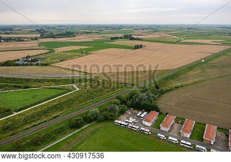 Diksmuide, Flanders, Belgium - August 3, 2021: Aerial View On Wide Agricultural Landscape Se Of Ijze