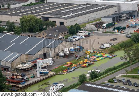 Diksmuide, Flanders, Belgium - August 3, 2021: Aerial View On Canoe Producing And Renting Out Busine