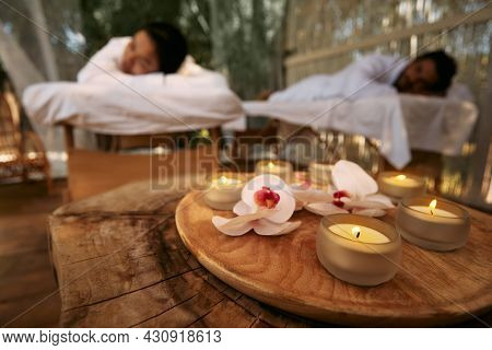 Aroma Massage For Couple. Couple Lying On Massage Tables During Day-spa And Romantic Weekend With Ca