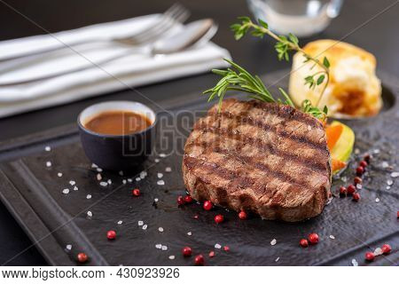 Grilled Beef. Tenderloin Steak On Stone Plate With Grilled Vegetables. Filet Mignon Concept.