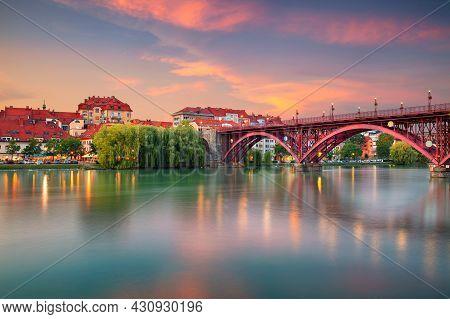 Maribor, Slovenia. Cityscape Image Of Maribor, Slovenia At Beautiful Summer Sunset With Reflection O