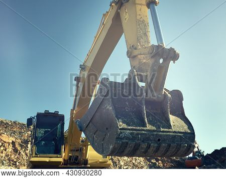 Excavator Scoop During Road Construction On The Rocky Soils. Heavy Machinery At Earthmoving, Digging