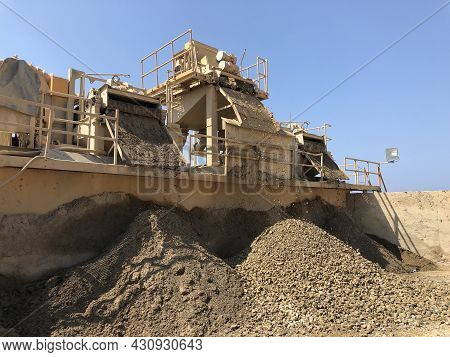 Different Sized Crushed Stone Fall Out Of Stone Crashing Machine. Producing Of Construction Material