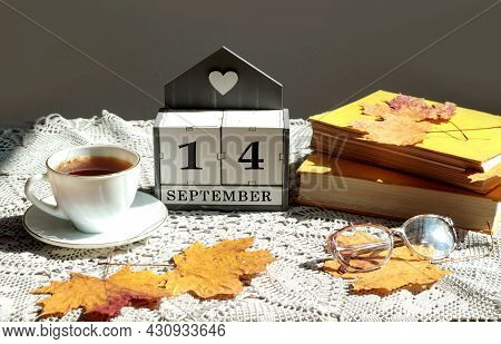 Calendar For September 14 : The Name Of The Month In English, Cubes With The Number 14, A Cup Of Tea