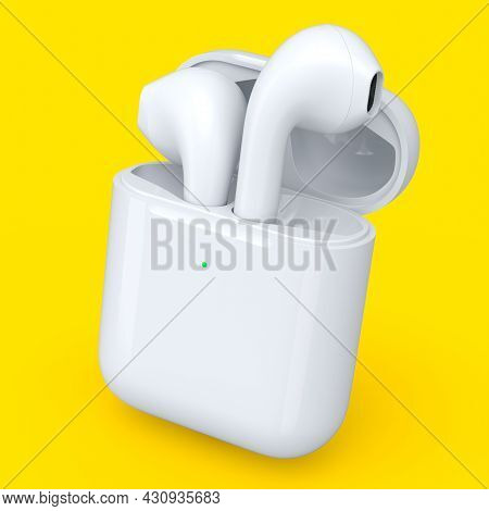 Wireless Bluetooth Headphones In White Case Isolated On Yellow Background