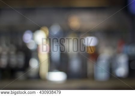 Blurred Restaurant Background With Lights And Bar Counter - Shallow Dof