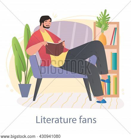 Love Of Reading Concept. Literary Fan Sits On Easy Chair And Holds Interesting Book. Male Character