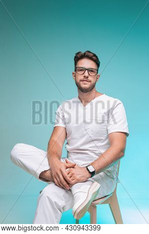 Professional Doctor Young Male Physician Friendly Successful Practitioner In Glasses. Healthcare And