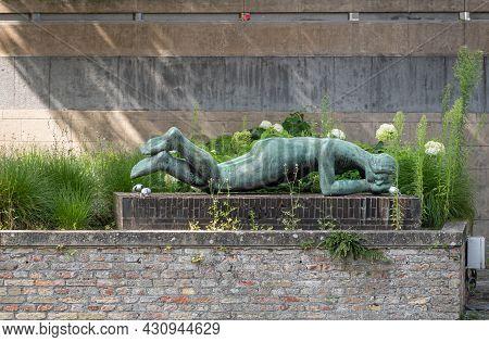 Brugge, Flanders, Belgium - August 3, 2021: Closeup Of Green Bronze Statue Of Horizontal Lying Woman