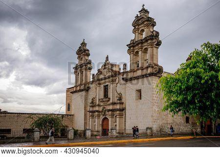 Cajamarca, Cajamarca/peru - 16.12.2019: Peruvian Locals Passing By The