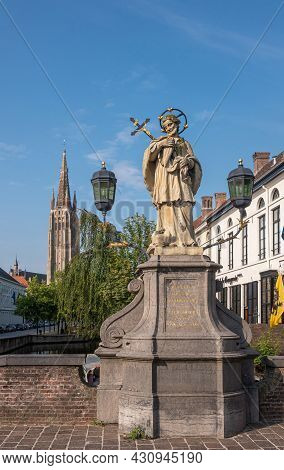 Brugge, Flanders, Belgium - August 4, 2021: Closeup Of Nepomucenus Stone Statue On His Bridge With N