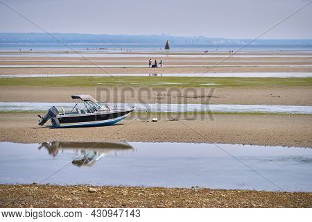 Maple Beach In Point Roberts Usa. A Boat Beached On The Sand At Boundary Bay At Low Tide In Point Ro