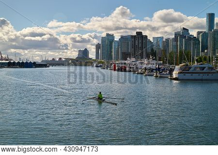Vancouver, British Columbia, Canada - July 2, 2018. Coal Harbor Rower Stanley Park. A Rower In Coal