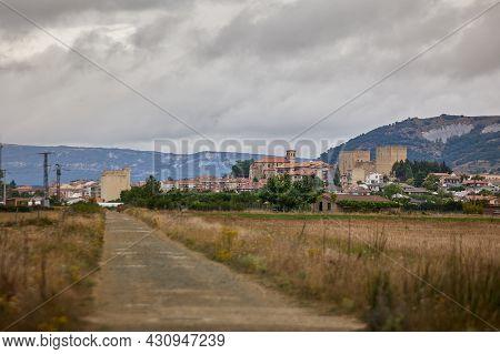 Rural Road With The City Of Medina De Pomar, Burgos.spain