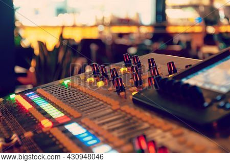 Working Sound Panel. Sound Mixer. Professional Audio Mixing Console With Lights, Buttons, Faders And