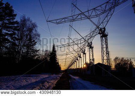 Antenna Array. A Long Row Of Radio Telescopic Antennas At The Sunset.