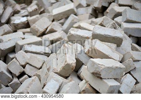 A Dump Of Damaged Gray Bricks On The Ruins
