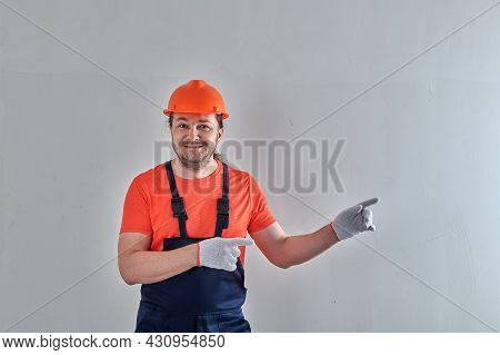 In The Apartment For Repair There Is A Man Against The Wall