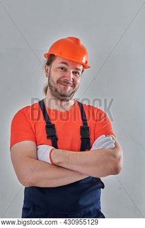 Portrait Of A Builder On A Wall Background