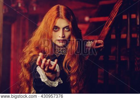 A portrait of a redhead witch  in her den. Magic, dark force, spell. Halloween.
