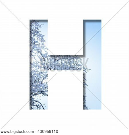 Winter Letters. The Letter H Cut Out Of Paper On The Background Of The Winter Sky And Snow-covered T