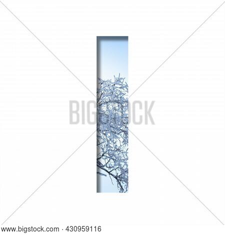 Winter Letters. The Letter I Cut Out Of Paper On The Background Of The Winter Sky And Snow-covered T
