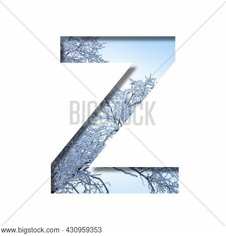 Winter Letters. The Letter Z Cut Out Of Paper On The Background Of The Winter Sky And Snow-covered T
