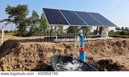 Water Pumps And Solar Panels. Groundwater Is Pumped With A Submersible Pump From Clean Energy Or Sol