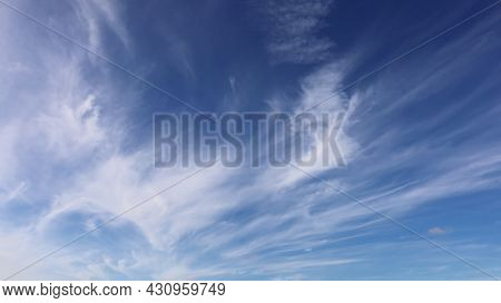 Beautiful White Clouds In The Blue Sky. The Shape Or Pattern Of Natural White Clouds Looks Strange A
