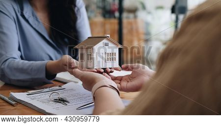 Real Estate Agent Or Sales Manager Offer Home Sale And Explained The Terms Of Signing The House Purc