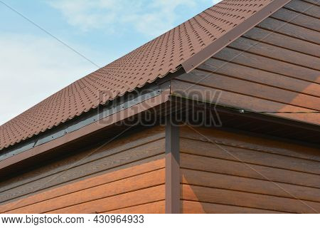 A Close-up Of A House Corner With Exterior Wood Siding Panels, Timber Cladding Walls With A Metal Ro