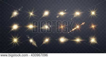 Gold Lens Flares Set. Isolated On Transparent Background. Sun Flash With Rays Or Gold Spotlight And