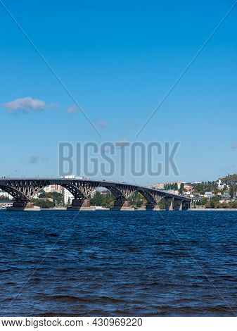 View Of The Big Bridge Over The Russian Volga River And The Bank Of The City Of Saratov