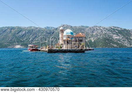 Kotor, Montenegro - 30 June, 2019: Church Our Lady Of The Rocks In Perast,  In The Bay Of Kotor, Mon
