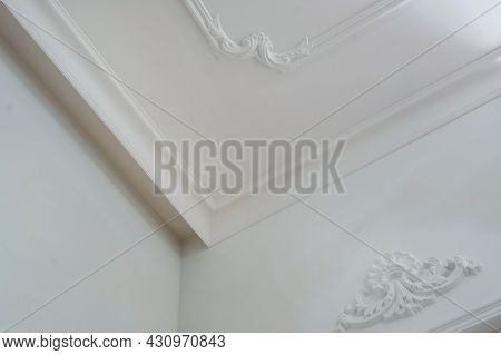 Detail Of Corner Ceiling And Walls With Intricate Crown Moulding