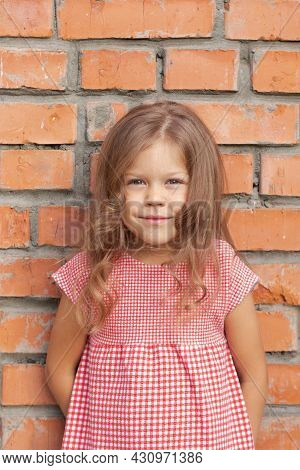 Smiling Caucasian Little Girl Of Five Years Old Looking At Camera