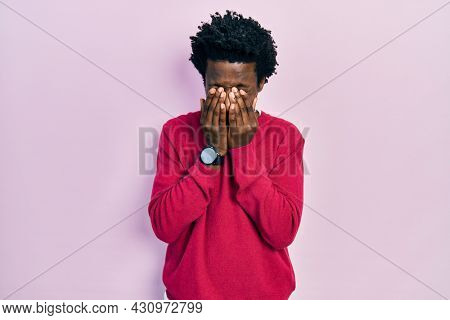 Young african american man wearing casual clothes rubbing eyes for fatigue and headache, sleepy and tired expression. vision problem