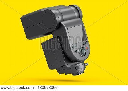 Camera External Flash Speedlight Isolated On Yellow Background.