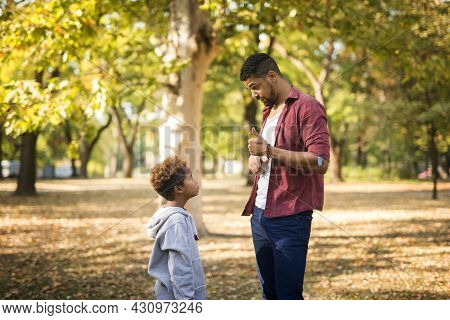 Father Criticizing His Disobedient Child For Bad Behavior.