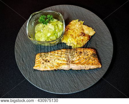 Grilled Salmon With Potatoe Gratin And Cucumber Salad