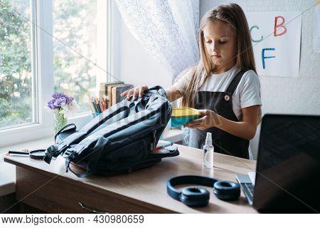 Back To School, Schoolchildren Hygiene, Safety Precautions After Coronavirus. The Schoolgirl Is Goin