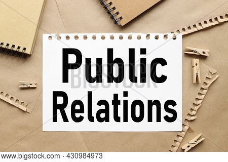 Public Relations. Text On White Notepad Paper On Craft Background