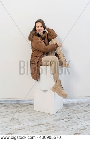 Young Woman Wearing Jacket On White Background.