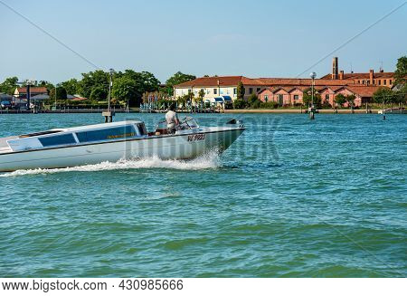 Murano, Italy - June 2, 2021: White Water Taxi In Motion In The Venice Lagoon In Front Of The Murano