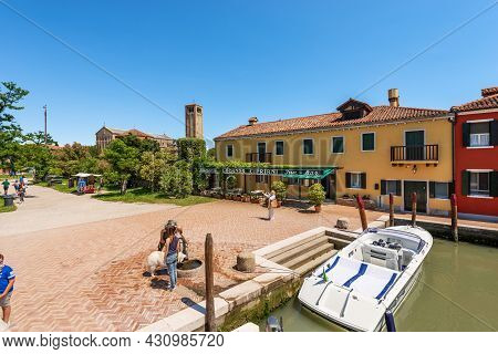 Torcello, Italy - June 2, 2021: Dock Of The Torcello Island And The Basilica And Cathedral Of Santa