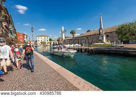 Lazise, Italy - May 26, 2021: Port Of The Small Village Of Lazise, Tourist Resort On The Coast Of La