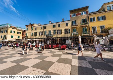 Lazise, Italy - May 26, 2021: The Main Square In Lazise Village, Piazza Vittorio Emanuele. Tourist R