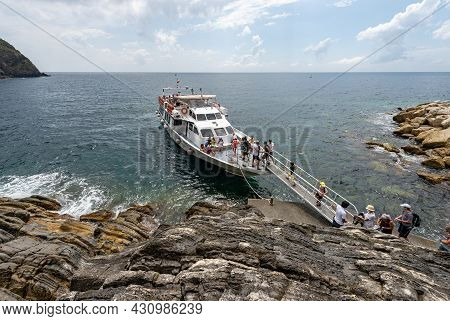 Riomaggiore, Italy - July 8, 2021: Ferry With Tourists Docked In Front Of The Small Village Of Rioma