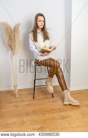 Woman With Book On White Background. Autumn