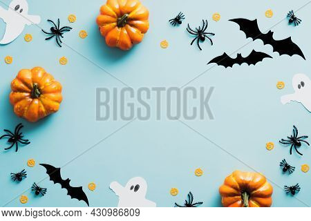 Happy Halloween Holiday Concept. Halloween Decorations, Bats, Ghosts, Spiders, Pumpkins On Blue Back